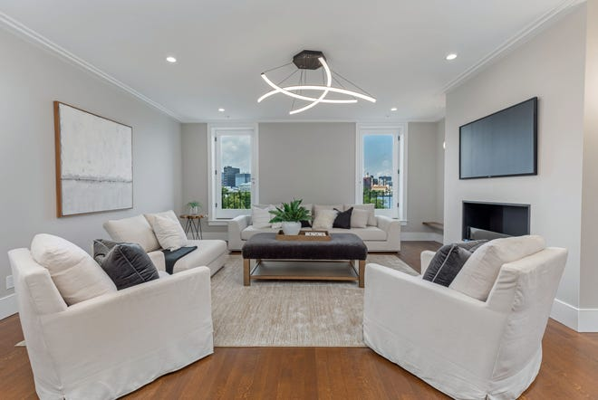 The spacious living area features an EcoSmart fireplace that burns bioethanol. The room is also wired for a TV that hangs over the fireplace.