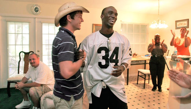 Seconds after being drafted by the Pittsburgh Pirates Andrew McCutchen, 18, center, is congratulated by his friend and former teammate Jerrod Tisko at his home in Fort Meade in 2005 while about 15 of his family and friends hollar with joy beyond them. McCutchen became the first Polk County player to be drafted in the first round of the MLB Amateur Draft.