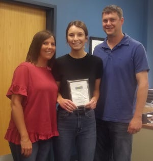 Jayden Henry (center) holds her Southeastern Student of the Year plaque.