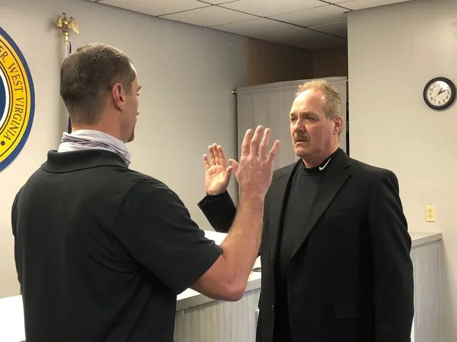 Ron Metcalf is sworn into office by Keyser city administrator Jeff Broadwater on Feb. 25. Tuesday, Metcalf resigned from that office effective at noon.