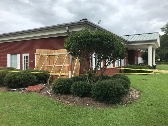 Two Niceville women were injured Tuesday when a motorist crashed into the wall of an Eglin Federal Credit Union in Bluewater Bay.