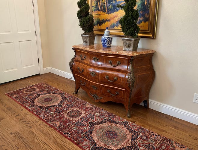 For one household, a hand-woven entryway rug marks the threshold and commemorates the end of an era. The art piece symbolizes the moment where they opened their front door again to the world.