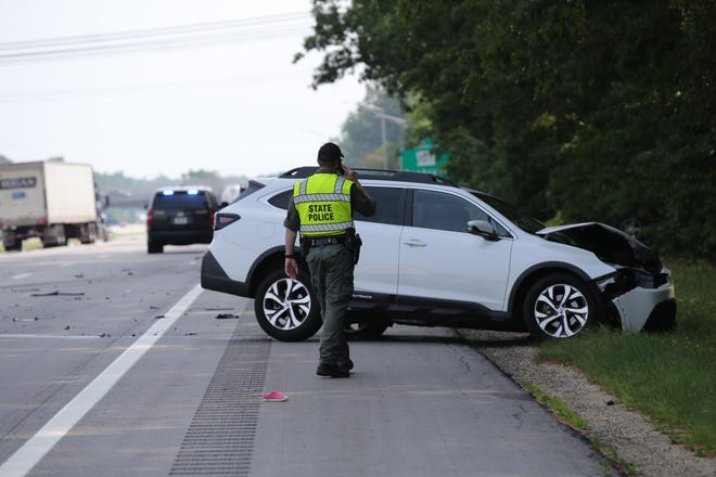 State police are seen investigating July 6, 2021, fatal crash that took place on Interstate 95 in Seabrook. A white Subaru Outback traveling northbound on I-95 crossed the grassy median and went into southbound I-95 traffic, striking a 2016 Jeep Wrangler.