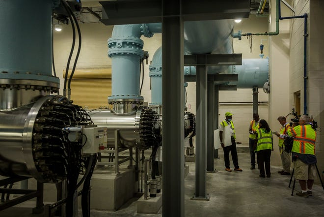 Dr. Poonam Kalkat, Director of Public Utilities for the City of West Palm Beach led a tour of the West Palm Beach Water Treatment Plant in West Palm Beach, Fla., on Tuesday, July 6, 2021. Dr. Kalkat and members of the press tour the room that houses ultraviolet light purification process at the water treatment facility.