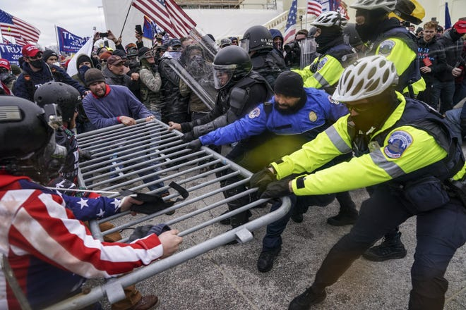Trump supporters try to breach a police barrier at the Capitol in Washington, D.C., on Jan. 6, 2021.