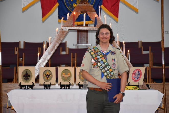 Newly named Eagle Scout Christopher Monnette, of Wellington, poses with his Boy Scouts of America awards, including a National Medal for Outdoor Achievement.
