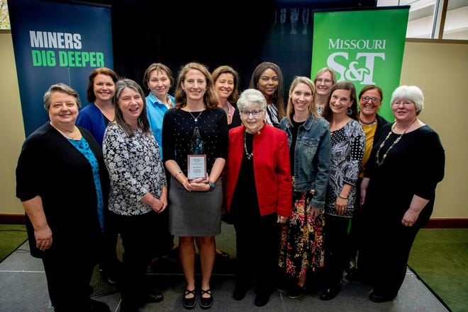 Dr. Kathleen Sheppard (center, holding award) receiving the 2019 Woman of the Year award at Missouri S&T, pictured along with previous winners of the award. Photo by Tom Wagner, Missouri S&T