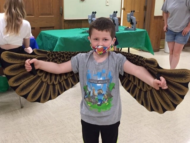 """Jackson Carter had fun flapping his eagle's wings at the library's recent """"Bird Buddy"""" program."""