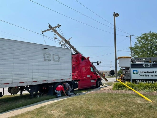 Route 14 near Market Square Drive was closed for about two hours Sunday after a Nevada man while allegedly intoxicated drove this semi-truck into a utility pole early Sunday afternoon.