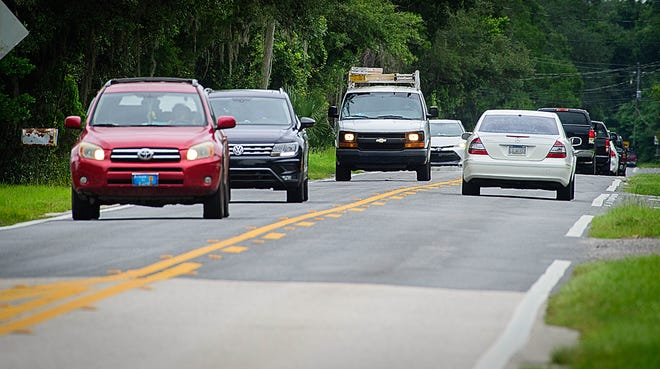 Vehicles Tuesday travel on Old Moultrie Road, south of St. Augustine. St. Johns County plans to make improvements to the road.