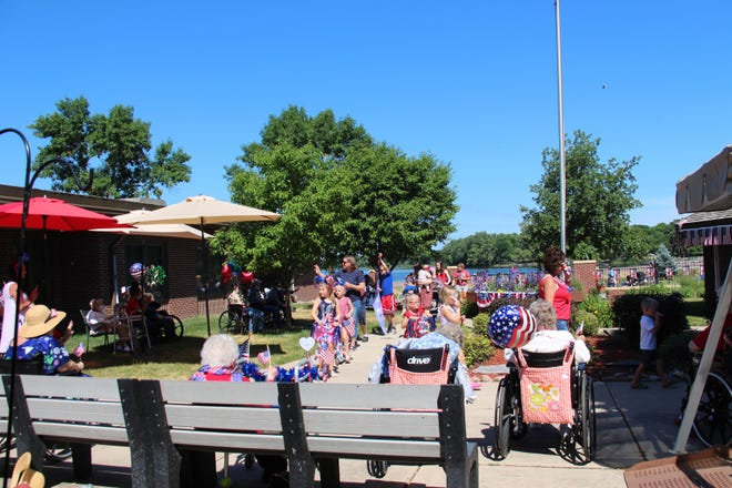 On June 30 Divine Providence hosted a patriotic kiddie parade through their courtyard—a delightful treat for the residents.