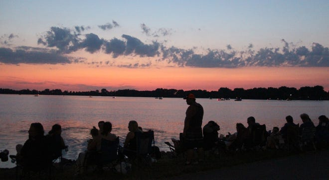 The shore of Sleepy Eye Lake and boats on the lake were filled with people waiting to see the fireworks display Sunday night. Fireworks are provided by the City of Sleepy Eye and shot by the Sleepy Eye Fire Department.