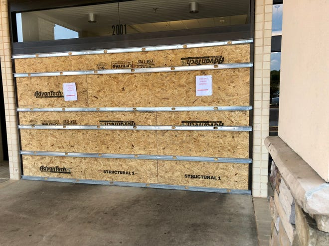 One of the entrances of Cleveland Mall is boarded up after a man drove a car through it.