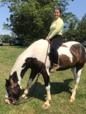 Sydney Thurber poses at her equestrian center in Lawndale.