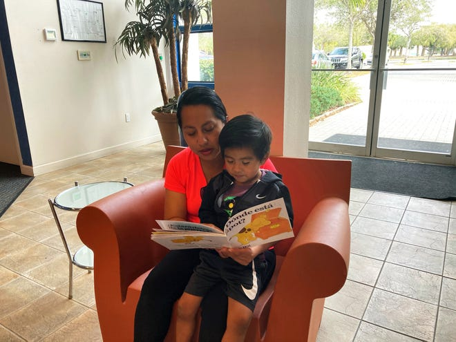 Maria Orozco, a participant in the HIPPY program, reads to her son, Dylan Mendoza.