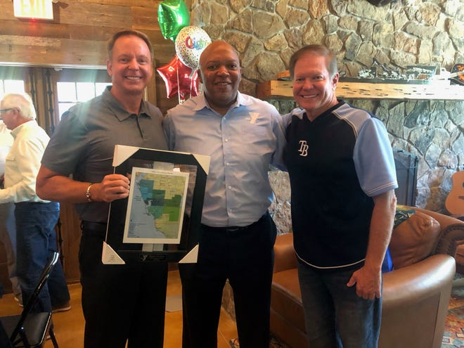 """YMCA of Southwest Florida president and CEO Gene T. Jones, center, with Keith Farlow, left, and David Dignam. """"The level of commitment and expertise of the YMCA of Southwest Florida Board of Directors is tremendous,"""" Jones said."""