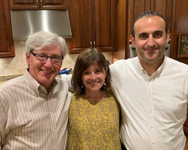 The author with her husband, DC, left, and rug merchant Hakan Zor.