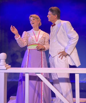 """Diane Dietz as Marian Paroo and Rich Beans as Harold Hill in the Legacy Theatre production of """"The Music Man."""""""