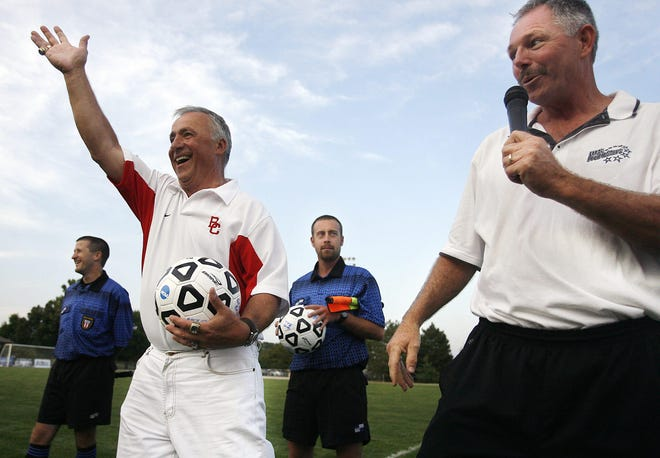In this Aug. 27, 2008, file photo, former UIS soccer coach Aydin Gonulsen, left, greets the crowd after being given a game ball by then-coach Joe Eck, right, during an exhibition game at Kiwanis Stadium.