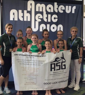 Students from Rising Stars Gymnastics of Shawnee recently competed at the AAU Nationals in Savannah, Ga. On the front row from left to right are: Taylor Reyes, Juliet Troutz, Rilynne Roberts and Aria Griggs. On the back row (left to right) are Coach Katie Schumacher, Kassidi Lowden, Karlee Linn, Ocean Minor, Kylee Marshall and Coach Debbie Simonson.