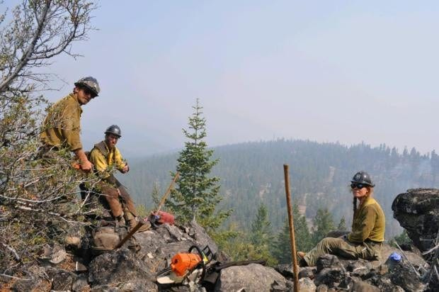 Hand crews work on the Tennant Fire on July 3, 2021.