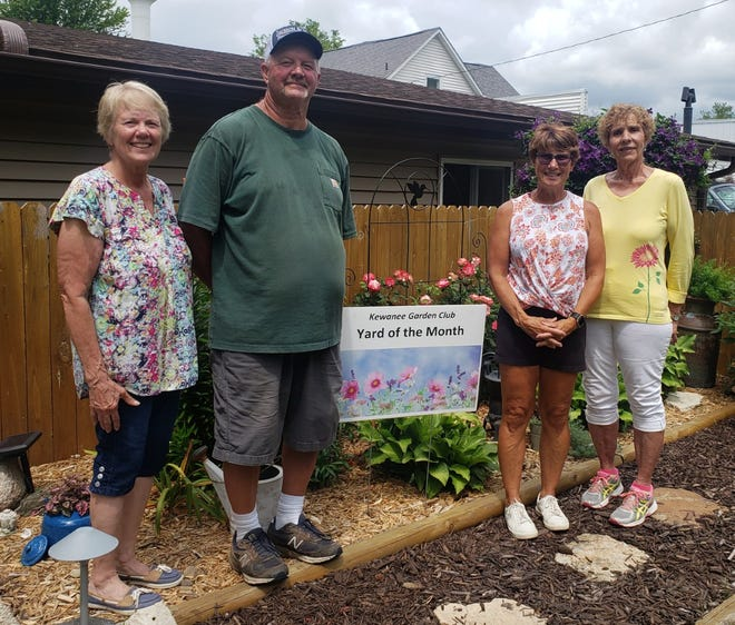 """July """"Yard of the Month"""" winners were announced by the Garden Club of Kewanee last week and awarded to Tammy and Ed Jackson on West Garfield Street. From left: Joline Oswald, club president; homeowners Ed and Tammy Jackson; and garden club member and co-chair Carol Appell."""