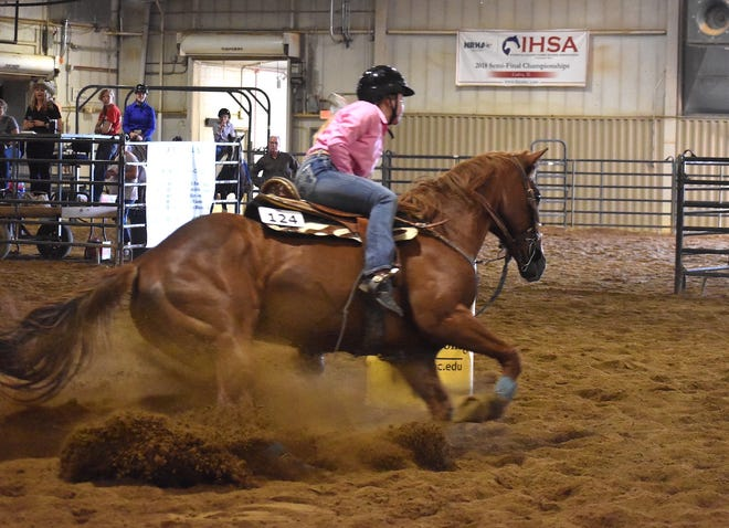 Preslee Weida of Kewanee FFA spins her horse during a barrel race at the Section 3 horse show on Thursday, July 1, at Black Hawk College, East Campus, Galva.