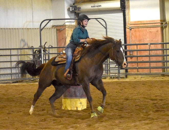 Kara Bryner of Kewanee FFA thunders home in the barrel race at the Section 3 horse show on Thursday, July 1, at Black Hawk College, East Campus, Galva