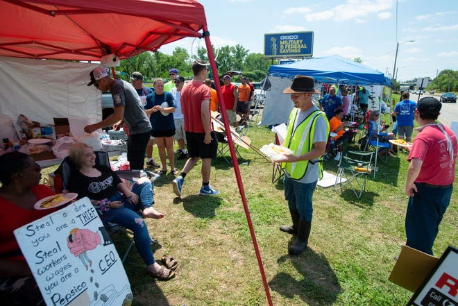 Workers are on strike across from Topeka's Frito-Lay plant, 4236 S.W. Kirklawn Ave. Community members and local businesses donated food to support strikers.