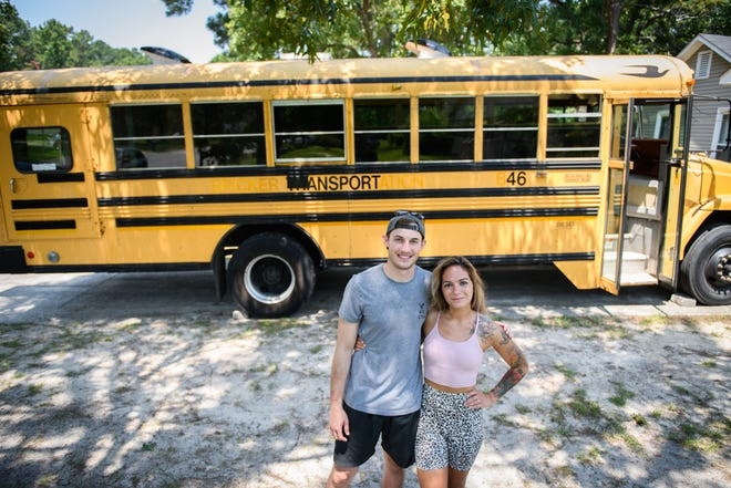 Fort Bragg couple, Ginnie and Austin Miller, are renovating an old school bus to travel in once they get out of the military.