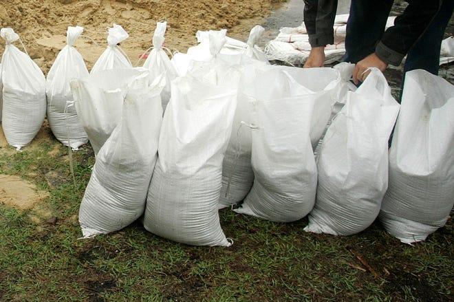 Residents pack sandbags in Cedar Key in this 2006 file photo.