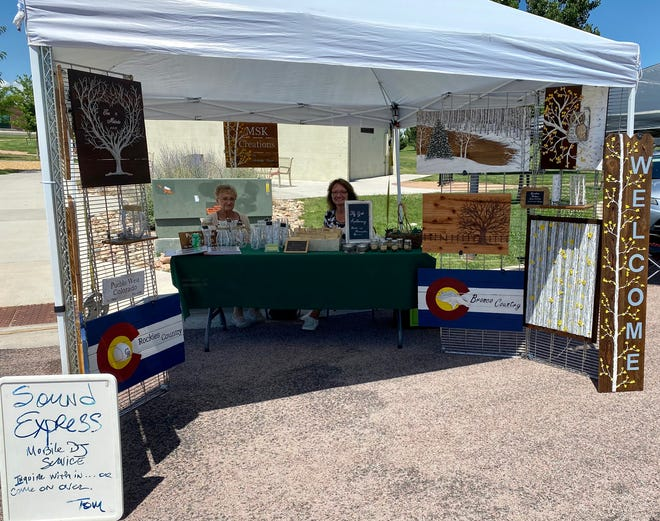 Renee Wing (left) and Melinda Kirsch (right) run a booth at the Pueblo West Community Marketplace.
