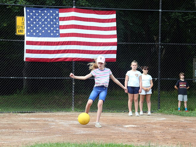 Skyla Austin lines up her shot while playing a game of kickball with the other Adventure Club campers in Hingham on Tuesday, July 6, 2021.