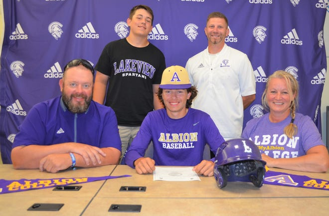 Joined by his family and Spartan head coach Kyle Kracht, Lakeview's Sawyer Shotwell participates in a signing ceremony as he makes his commitment to play baseball at Albion College.