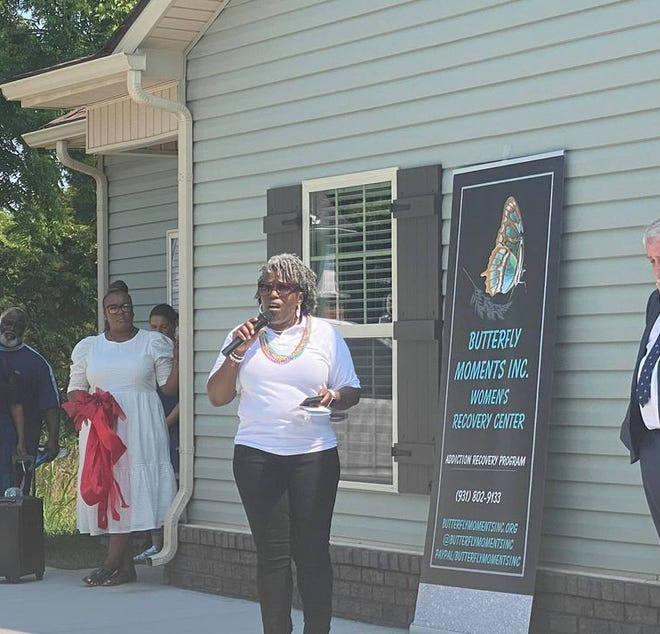 Butterfly Moments Inc., founder Mary Laremore speaks at the recovering veterans housing ribbon cutting ceremony July 4, 2021.
