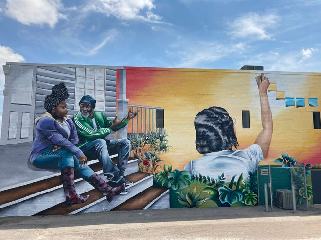 """A portion of the mural """"Future"""" can be found at 1171 7th St., on the exterior of the Evelyn K. Davis Center for Working Families."""