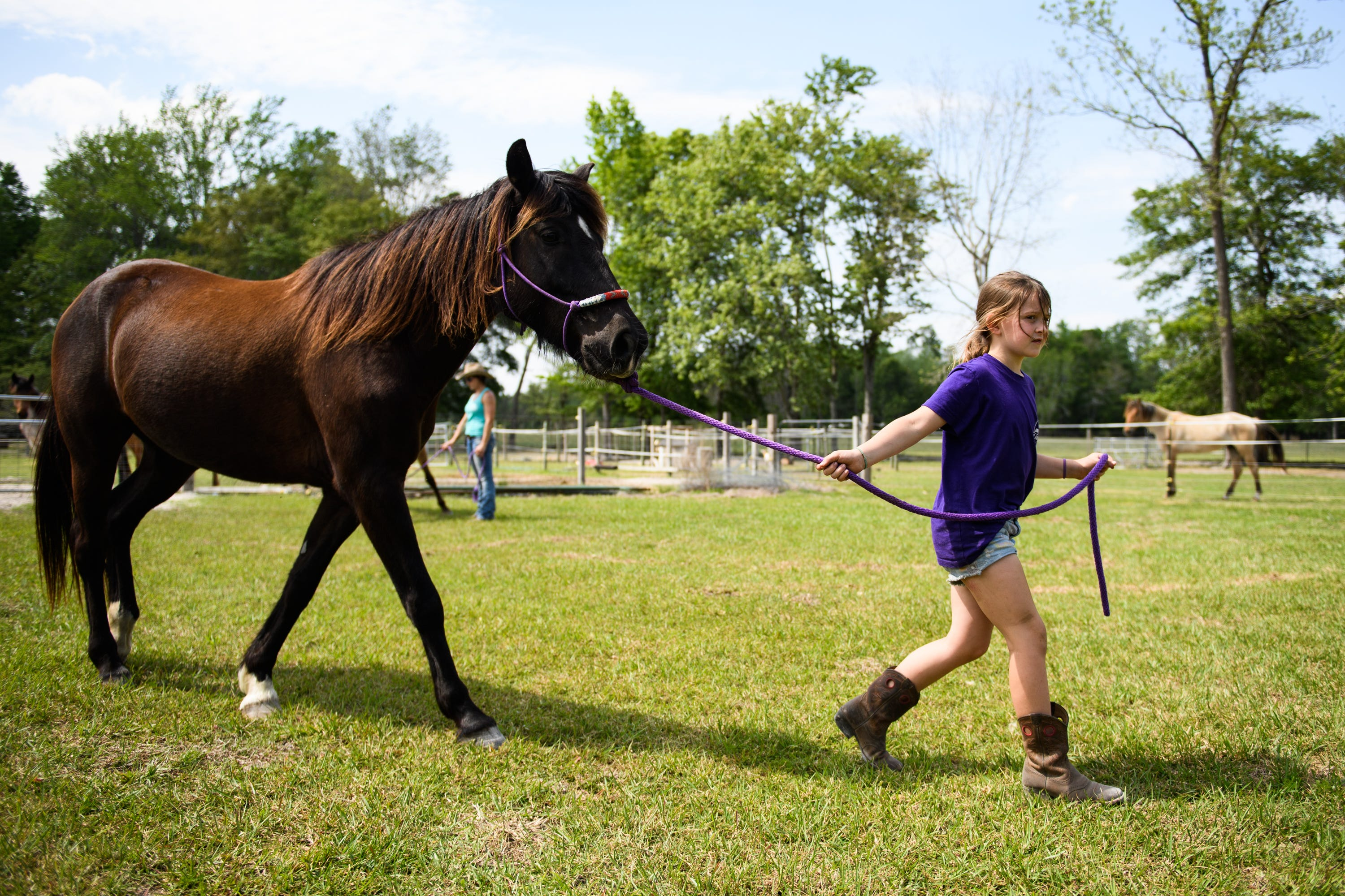 Annareese Hawkins walks Po Boy before taking him on a short ride at the family farm on April 15, 2021.