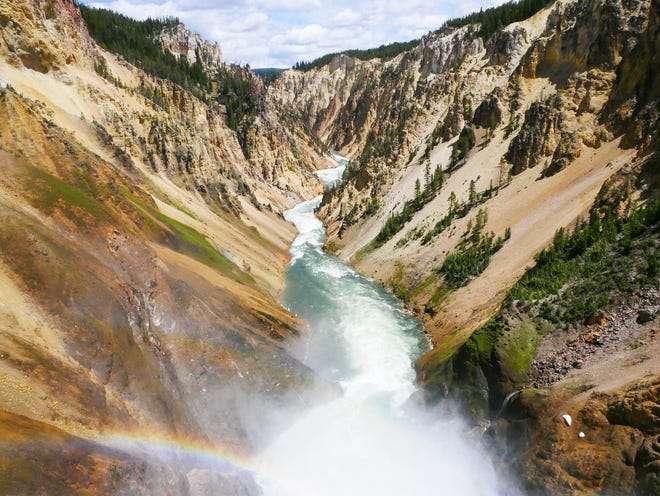 This June 17, 2017 image shows the Yellowstone River flowing through the Grand Canyon in Yellowstone National Park, Wyoming. The first episode of the Parks podcast highlights stories of Native American tribal members who live near the Yellowstone area (Matt Dahlseid/Santa Fe New Mexican via AP)