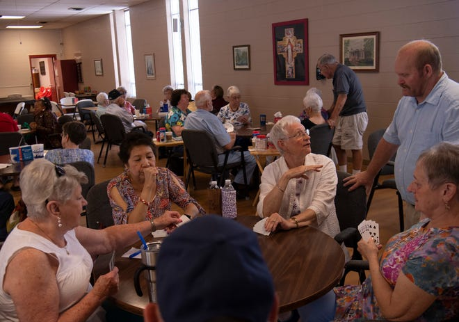 A game of 311 offers a chance for friends to catch up on the first day of re-opening The Gathering Place senior center Tuesday afternoon, July 6, 2021. The facility has been closed since March 11, 2020, due to the COVID-19 pandemic