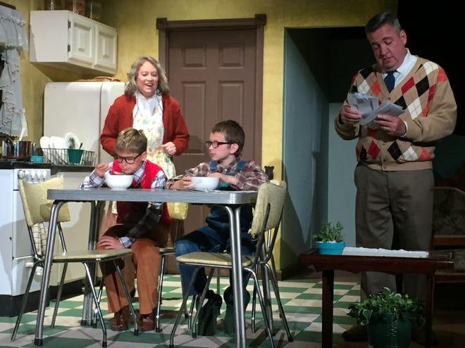 "Alisha Miller, Dane Kuzma, Everett Breedlove and John Moser rehearse a scene from ""A Christmas Story"" at the Mansfield Playhouse."