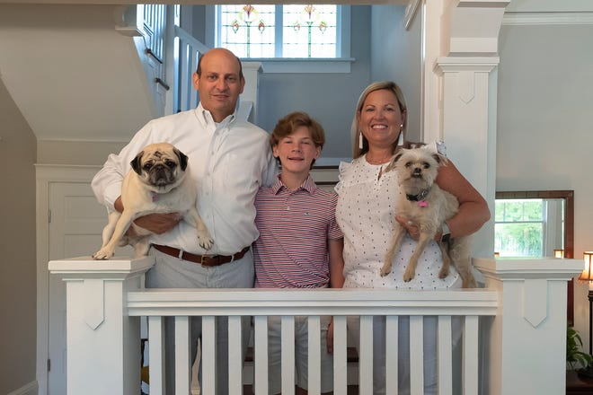 Bob, Joseph and Kim Weiss, and their canine companions Lola and Willy, are happy in their new home.