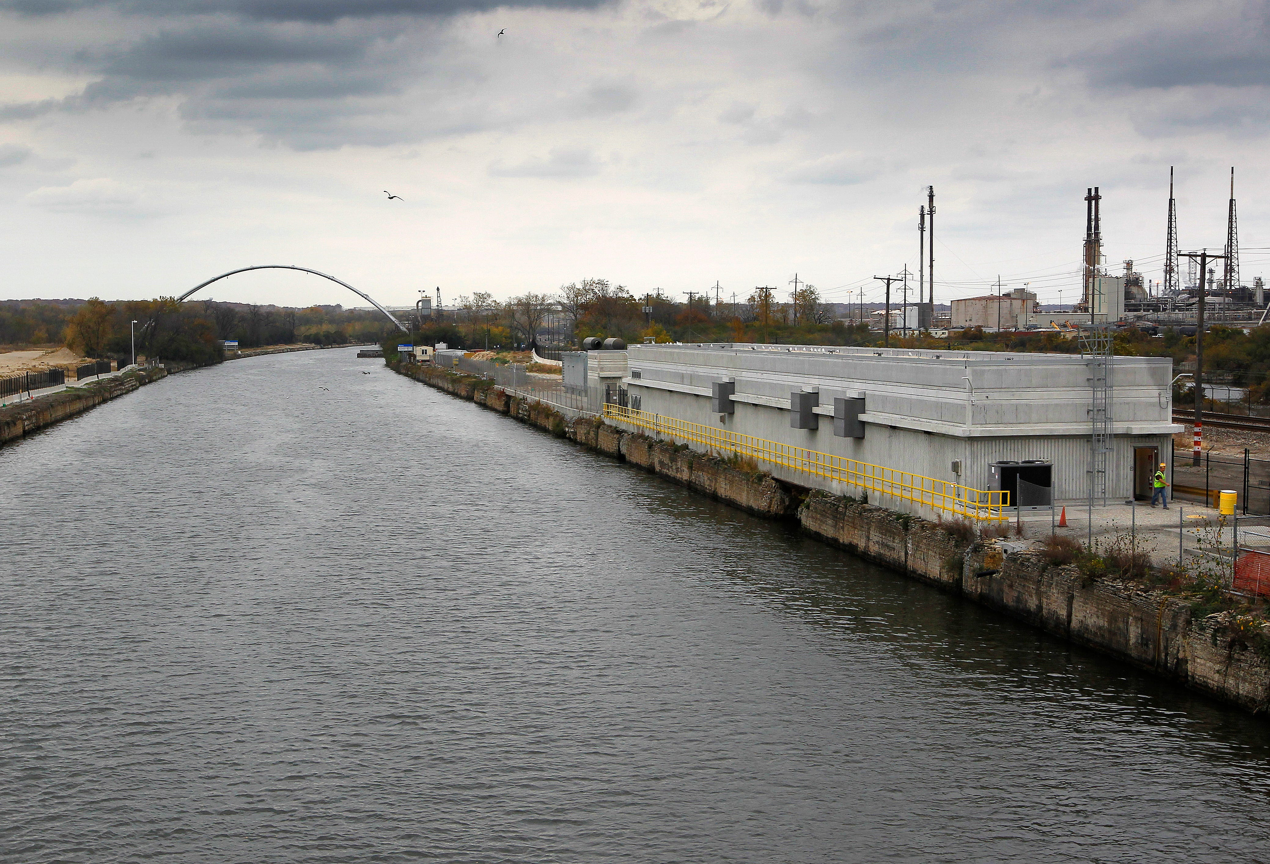 RIVER PLUG, NWS, PORTER, 8. - The Electric Ship Barrier, right, is designed to stop the movement of Asian Carp towards the Great Lakes. The highly industrialized Chicago Sanitary and Ship Canal is the major access for shipping for some industries along it's banks. There is a controversial plan that could involve plugging the canal to halt the spread of the invasive Asian Carp to the Great Lakes through the canal, that could interrupt or stop barge traffic. October 17, 2012. GARY PORTER/GPORTER@JOURNALSENTINEL.COM