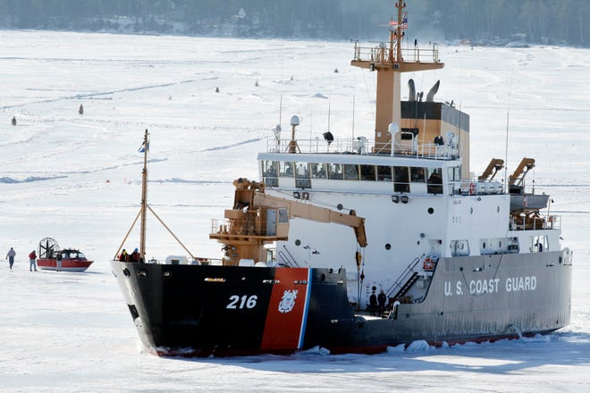The U.S. Coast Guard cutter Alder breaks ice near a windsled Wednesday, April 3, 2013 near the harbor in Bayfield, Wis. on Lake Superior. The Madeline Island ferry plans to resume running on Friday. Most traffic across Lake Superior between Bayfield and Madeline Island is either via the ferry or, in the depths of winter, the ice road. But when the ice is either breaking up or settling into its winter thickness, people can get across only by the wind sled - an enclosed boat-hulled craft with huge fans on the back that push the vehicle across the shifting ice.. The wind sleds are usually in action for 10 to 14 days at the beginning of winter and about a week in the spring, though the duration varies each year.