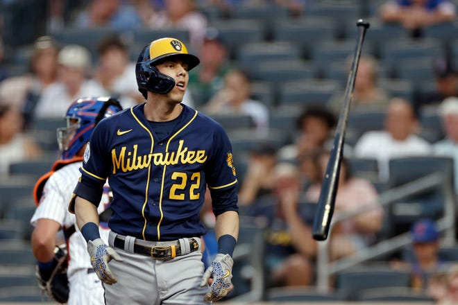 NEW YORK, NY - JULY 5: Christian Yelich #22 of the Milwaukee Brewers tosses his bat after striking out in the sixth inning against the New York Mets at Citi Field on July 5, 2021 in the Flushing neighborhood of the Queens borough of New York City. (Photo by Adam Hunger/Getty Images)