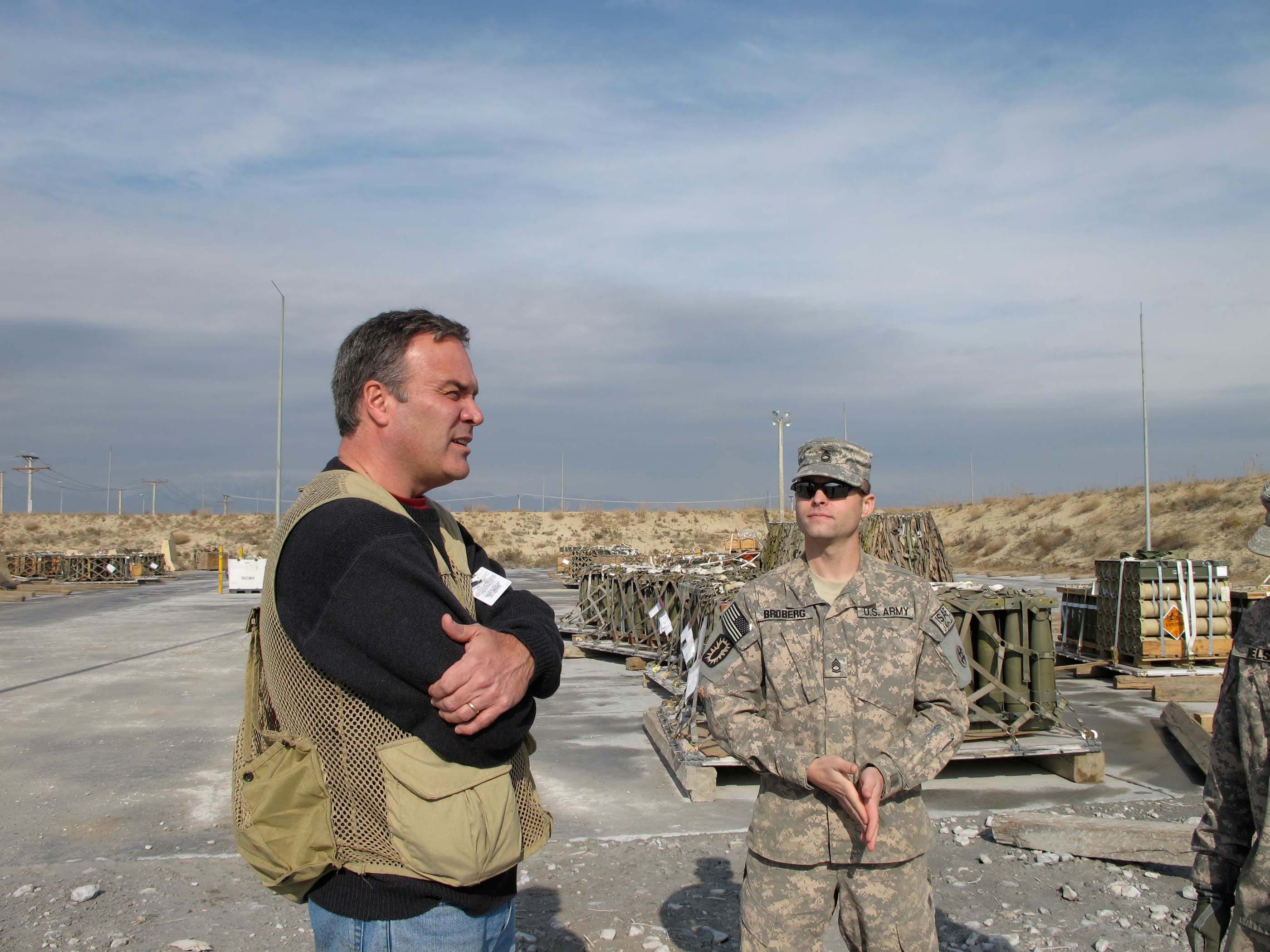 George Stanley interviews Sgt. 1st Class Carl Broberg at the Ammunition Supply Point at Bagram Airfield.