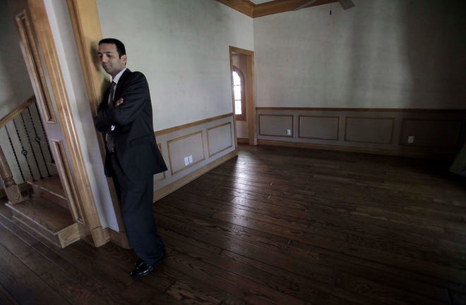 Shanoop Kothari stands in the Houston home he once shared with his wife and children. The couple's son, Harry contracted a bacterial infection after a low-risk medical procedure, and the Kotharis allege a contaminated alcohol wipe made by Triad Group Inc., of Hartland, was the culprit.