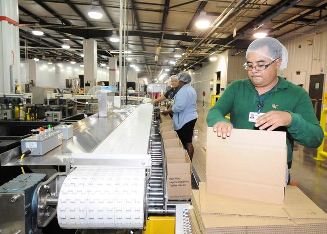 BABYWIPES --- Springdale Morning News Isidro Garcia, packaging operator, unloads boxes at Rockline Industries in Springdale November 17, 2010. ------------ CREDIT: Springdale Morning News