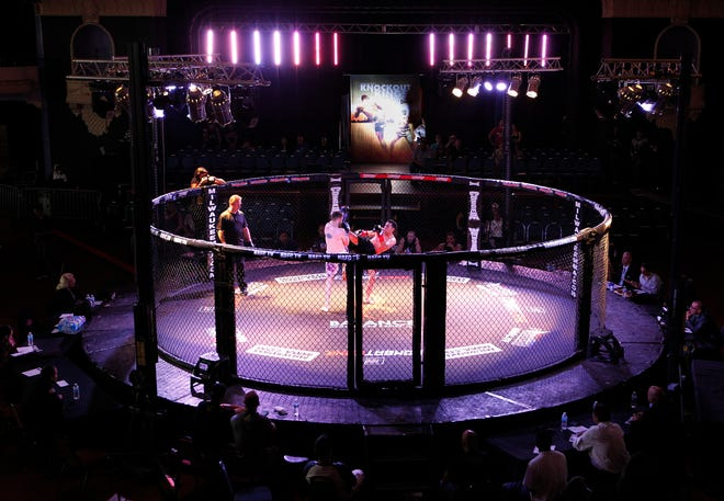 Fighters begin their bout during a Knockout Kings kickboxing even in July.