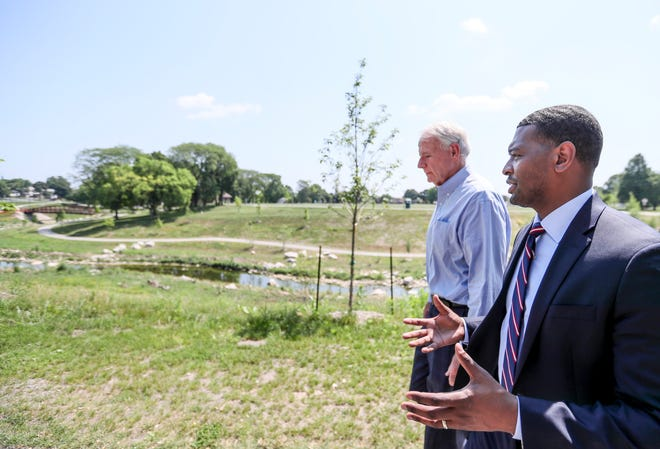 EPA Administrator Michael S. Regan and Mayor Tom Barrett talk  Tuesday, July 6, 2021, at Pulaski Park, 2701 S. 16th St. Regan, Barrett and other local, state and community leaders toured Pulaski Park, where the Milwaukee Metropolitan Sewerage Districthas restored the KinnickinnicRiver to a natural stream to reduce the risk of flooding.