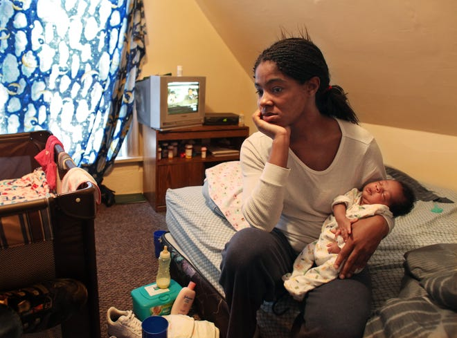 Lakisha Stinson and her daughter, Rashyia, who was born last month and is healthy, live in a Milwaukee neighborhood where the rate at which African-American babies die is worse than Botswana.